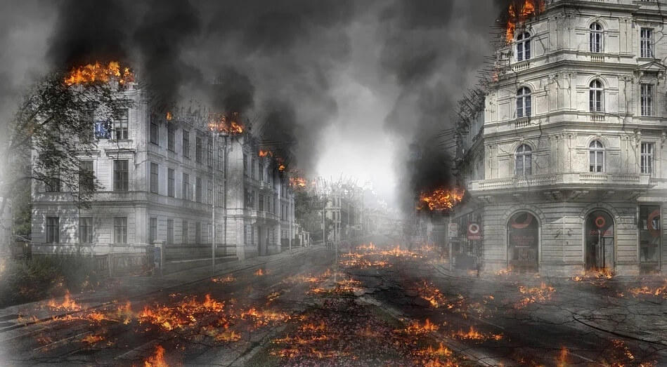 На фото изображены горящие дома, как после бомбежки.